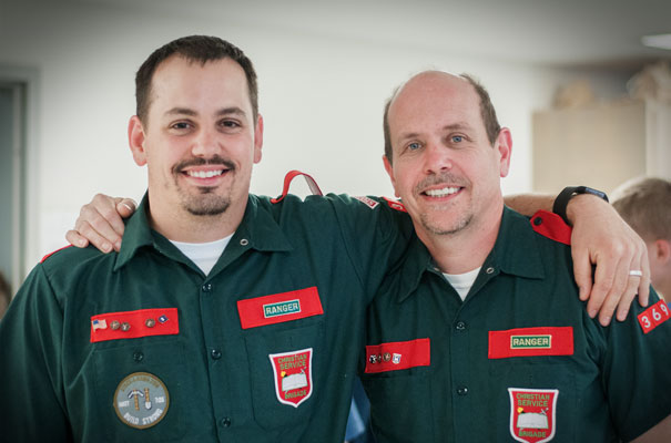 Brigade Leaders offering discipleship wearing green and red uniforms with unit bages