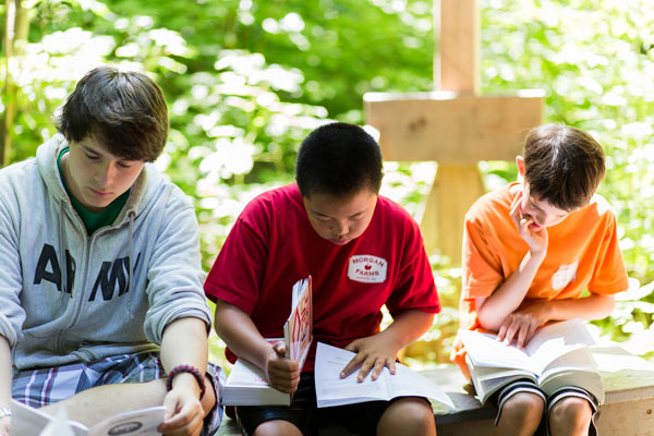 boys and teens studying word and learning to follow Jesus